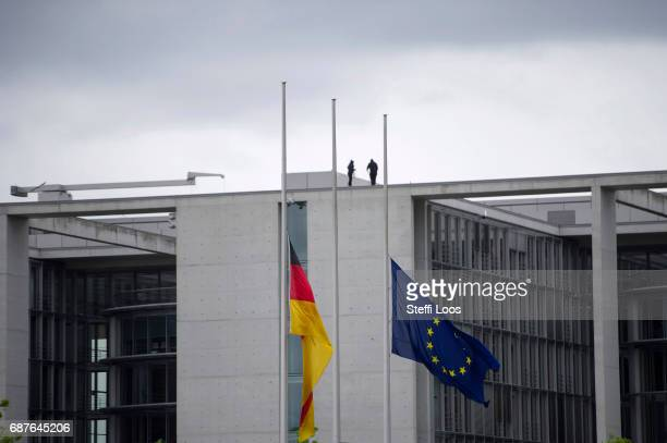 The European and the German flag fly at halfmast in front of the parliament building on May 24 2017 in Berlin Germany An explosion occurred at...
