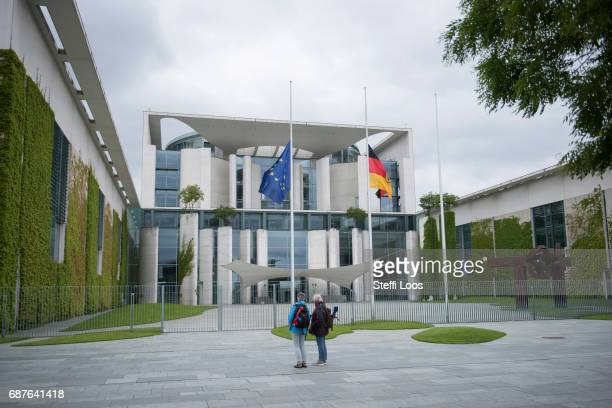 The European and the German flags fly at halfmast in front of the chancellery building on May 24 2017 in Berlin Germany An explosion occurred at...