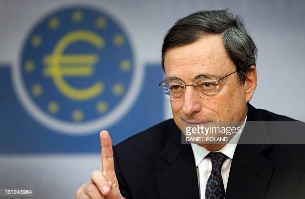 The European Central Bank's new chief Mario Draghi gestures during his first press conference at the ECB in Frankfurt/M western Germany on November 3...