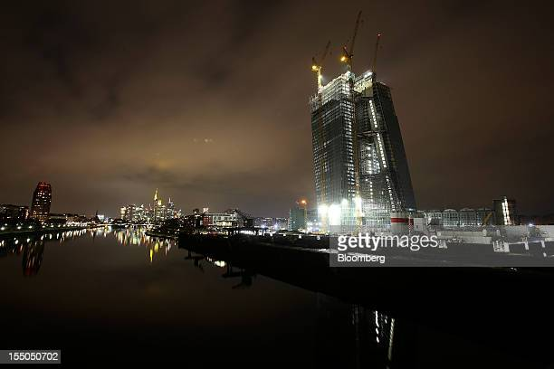 The European Central Bank's new headquarters still under construction right are seen from the River Main in Frankfurt Germany on Tuesday Oct 30 2012...