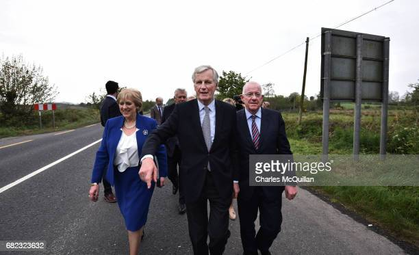 The European Commission Brexit chief negotiator Michel Barnier gestures towards the north as he is accompanied by Irish Foreign Affairs Minister...