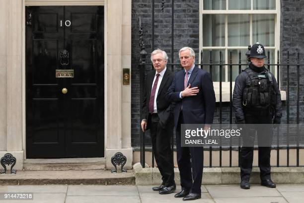 TOPSHOT The European Commission's Chief Negotiator for the UK exiting the European Union Michel Barnier is welcomed by the Secretary of State for...
