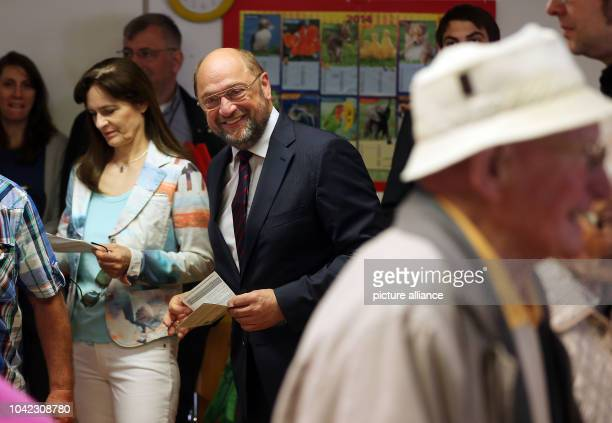 The European frontrunner of the Social Democrats Martin Schulz and his wife Inge are pictured during the voting of the European election 2014 in...