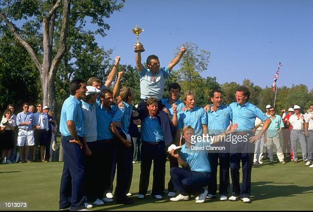 The European team celebrate with the trophy after their victory in the Ryder Cup at Muirfield Village in Ohio USA Europe won the event with a score...