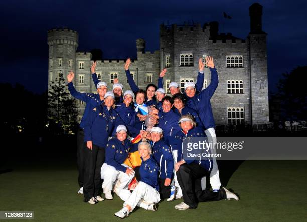 The European team celebrate with the trophy following their 1513 victory during the singles matches on day three of the 2011 Solheim Cup at Killeen...