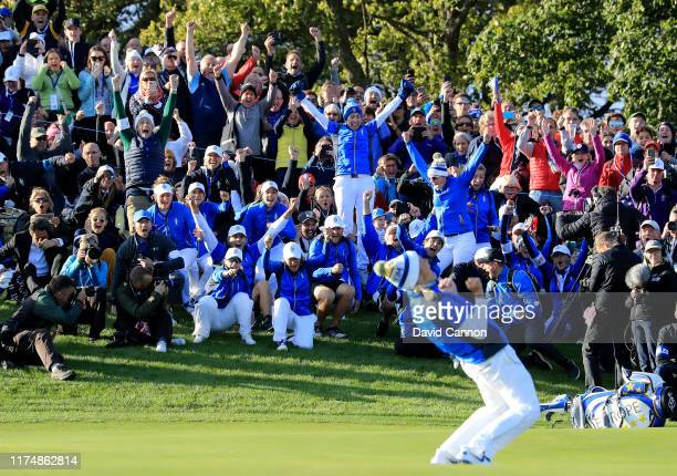 The European team erupt in excitement as Suzann Pettersen celebrates holing the winning putt during the final day singles matches in the 2019 Solheim...