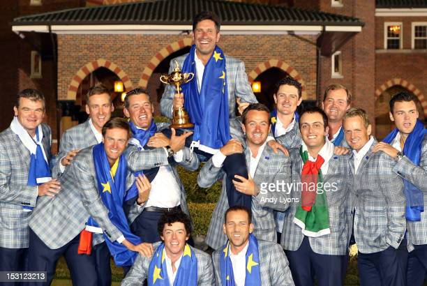 The European team hoist their captain Jose Maria Olazabal after Europe defeated the USA 145 to 135 at The 39th Ryder Cup at Medinah Country Club on...