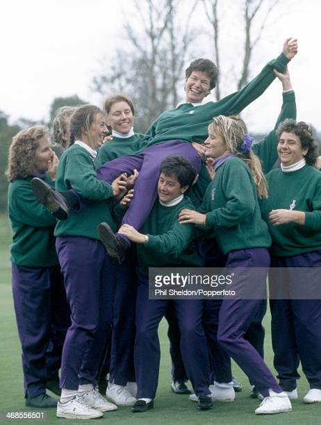 The European team lift nonplaying captain Mickey Walker after winning the Solheim Cup golf competition held at the Dalmahoy Golf Club Scotland 4th...