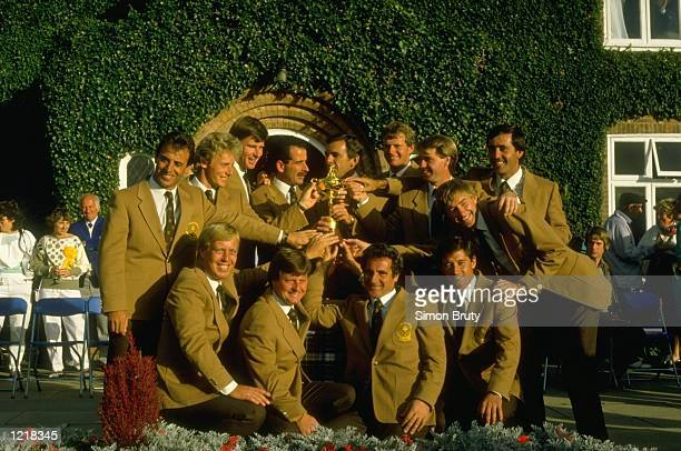 The European team pose for a photograph after the Ryder Cup at The Belfry Golf Club in Sutton Coldfield England Europe won the event with a score of...