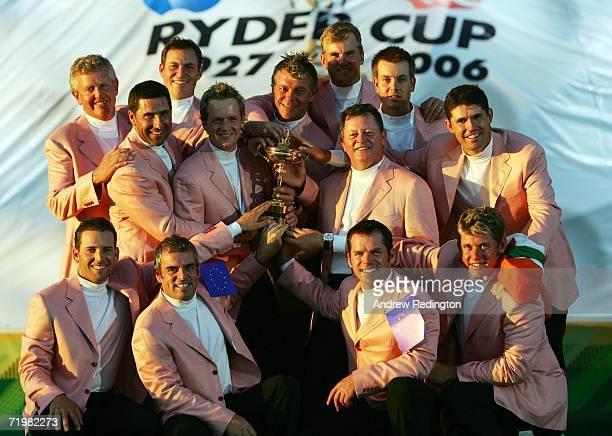 The European Team pose with The Ryder Cup Trophy during the closing ceremony after Europe win the Ryder Cup by a score of 18 1/2 9 1/2 on the final...