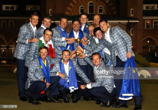 The European team poses with the Ryder Cup after Europe defeated the USA 145 to 135 at The 39th Ryder Cup at Medinah Country Club on September 30...