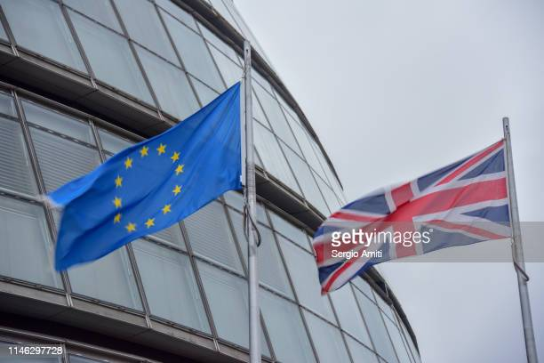 the european union and the british flags - brexit stock pictures, royalty-free photos & images