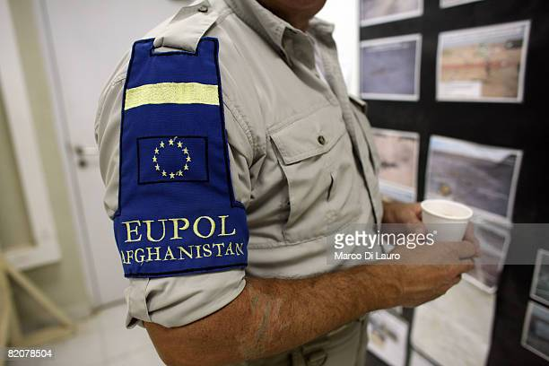 The European Union flag adorns the clothing of a British police officer working with the European Union Police force mentoring the Afghan Police at...