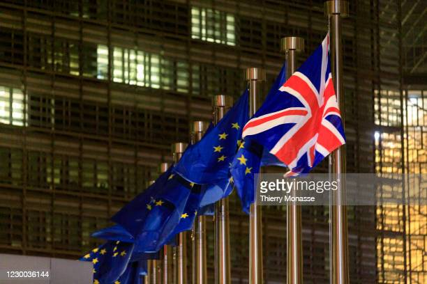 The European Union Flag and the Union Jack are seen in front of the Berlaymont, the EU Commission headquarter on December 09, 2020 in Brussels,...