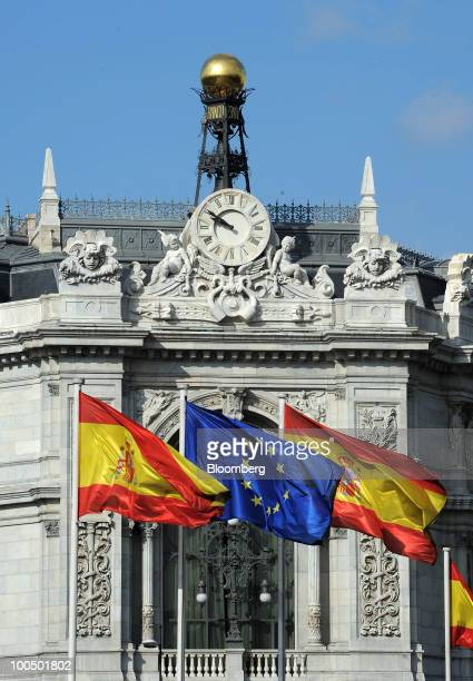 The European Union flag center flies between Spanish national flags at the Bank of Spain in Madrid Spain on Tuesday May 25 2010 Four Spanish savings...