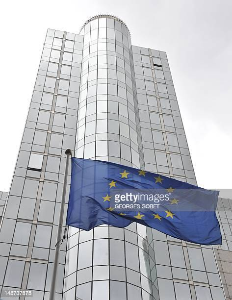 The European Union flag flies in front of the European Parliament in Brussels on July 19 2012 Eurozone finance ministers will hold a teleconference...