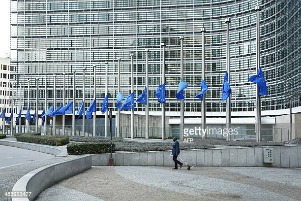 The European Union flags fly halfmast at the European Commission headquarters by the Berlaymont Building on December 6 to pay tribute following the...