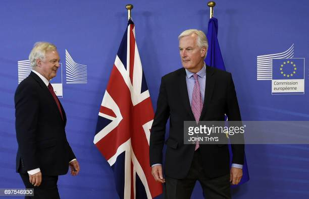 The European Union's chief negotiator Michel Barnier arrives with British Secretary of State for Exiting the European Union David Davis for a joint...