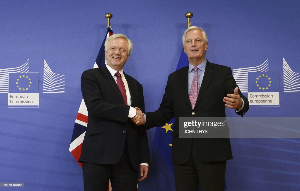 The European Union's chief negotiator Michel Barnier (R) shakes hands with British Secretary of State for Exiting the European Union (Brexit Minister) David Davis during a joint statement before the opening of Brexit negotiations at the EU headquarters in Brussels on June 19, 2017. The European Union's chief negotiator Michel Barnier on June 19, 2017 said he hoped for a 'constructive' start to Brexit talks with Britain as formal negotiations began in Brussels.'I hope that today we can identify priorities and a timetable that would allow me to report to the (EU summit) later this week that we had a constructive opening of the negotiations,' the Frenchman said as he greeted Britain's Brexit minister David Davis. THYS