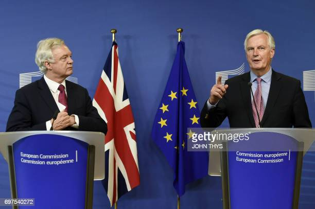 The European Union's chief negotiator Michel Barnier speaks as British Secretary of State for Exiting the European Union David Davis looks on during...