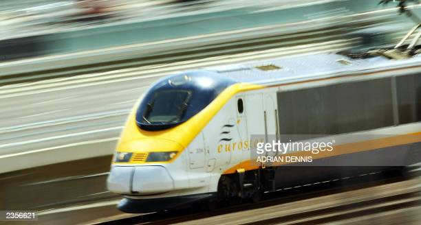 The Eurostar train speeds along a new section of the Channel Rail Link near Rochester Kent 40 miles east of London 30 July 2003 The train reached a...