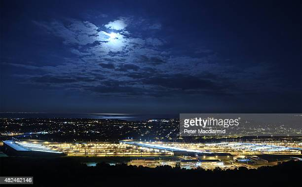The Eurotunnel terminal is illuminated by a rare blue moon on July 31 2015 in Folkestone England Hundreds of migrants are continuing to attempt to...