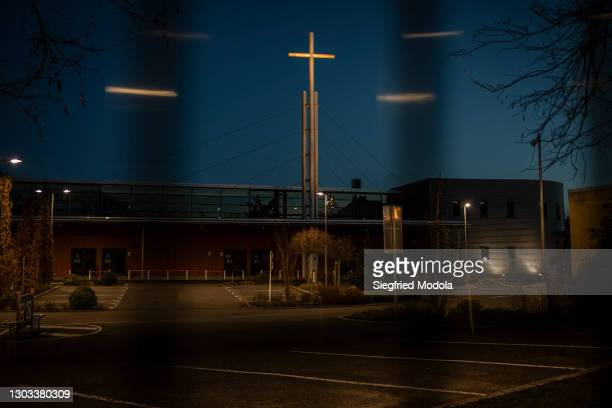 The evangelical Christian Open Door Church is seen through a gate on February 21, 2021 in Mulhouse, eastern France. A year into the pandemic and the...