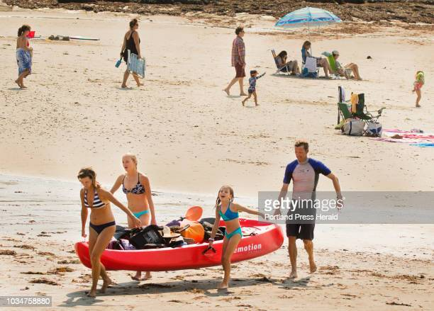 The Evans family front to back Heather Zoe Phoebe 9 and Devon of Cape Elizabeth carry what Heather jokingly referred to as a sitontop kayak barge off...