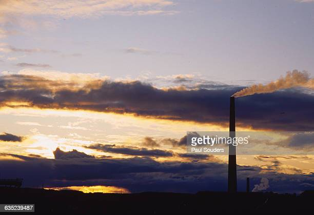 The evening alpenglow light illuminates the smoke from the smokestacks of the INCO Nickel Mine and Smelter