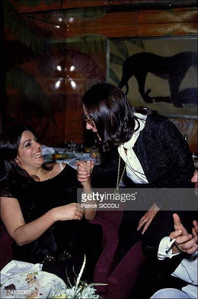 """The evening of S.Traboulsy at """"Regine"""" In Paris, France On December 02, 1982 - Christina Onassis and Nana Mouskouri."""