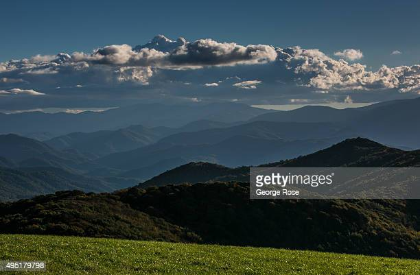 The evening sky and distant Tennessee horizon is viewed from Max Patch a bald mountain that is a favorite camping spot for those hiking the...