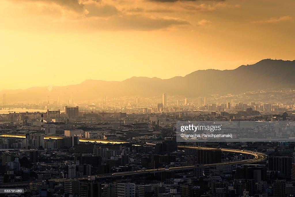 The evening sun shine to Osaka city skyline, Japan : Foto stock