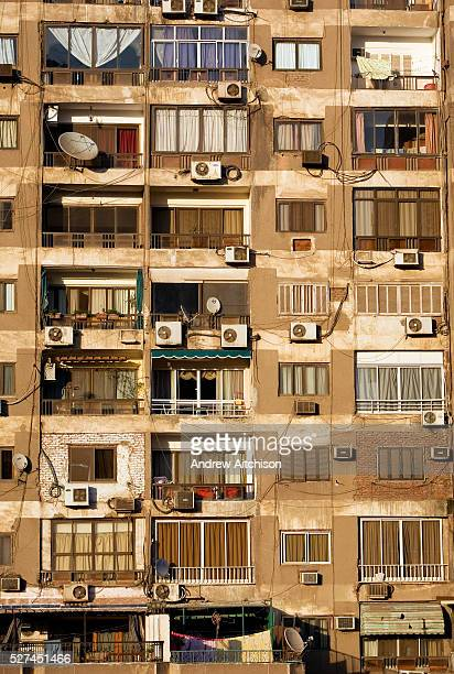 The evening sun warms the weathered facade of an apartment block in Cairos Zamalek district Zamalek is located on an island in the Nile River and...