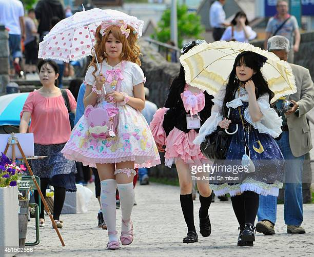 The event participants in Lolita fashion costumes walk along the canal on June 29 2014 in Otaru Hokkaido Japan About 90 girls and young women decked...