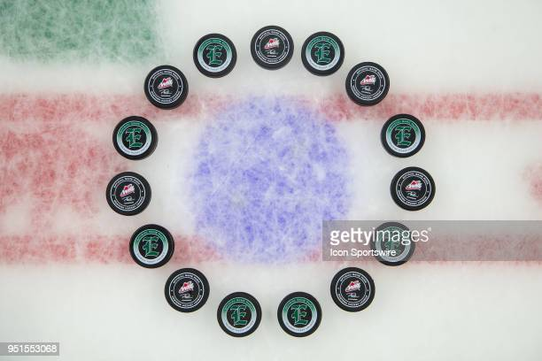 The Everett Silvertips lay pucks at center ice to honor the Humboldt Broncos before Game 2 of the second round of the Western Hockey League playoffs...