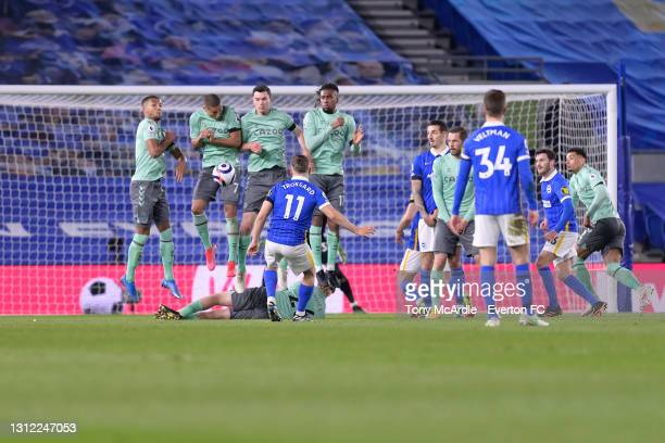 The Everton defensive wall blocks the free kick of Leandro Trossard during the Premier League match between Brighton and Hove Albion and Everton at...