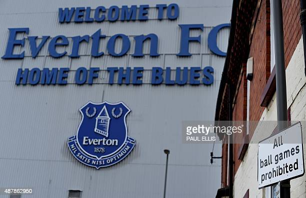 The Everton logo sits outside Goodison Park stadium ahead of the English Premier League football match between Everton and Chelsea in Liverpool...