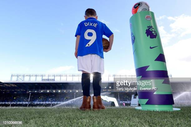 The Everton mascot waits next to the Premier League plinth and ball for the start of the Premier League match between Everton FC and Manchester...
