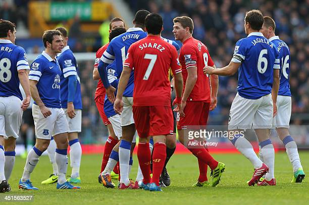 The Everton players react to Steven Gerrard of Liverpool following a challenge on Gareth Barry of Everton during the Barclays Premier League match...