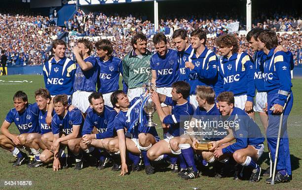 The Everton team celebrating with the League Championship trophy following their First Division match against Luton Town at Goodison Park in...