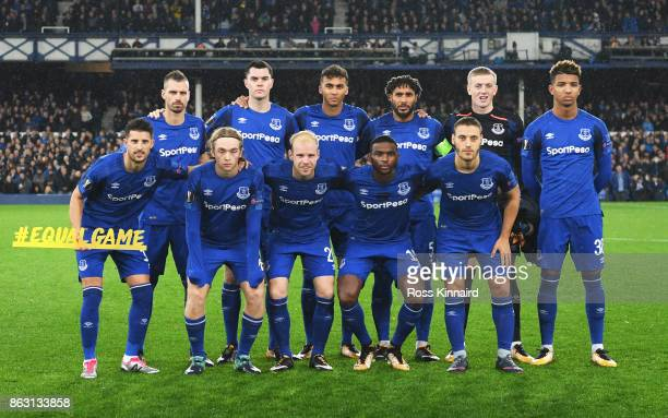 The Everton team line up with the #equalgame banner prior to the UEFA Europa League Group E match between Everton FC and Olympique Lyon at Goodison...
