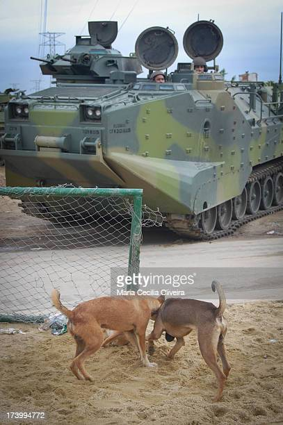 The everyday intact: dogs play in soccer goal Army helps military police occupation is the installation of the Police Pacification Unit , the Complex...