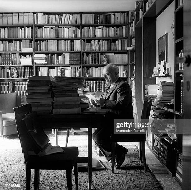 The ex Council President, the Christian Democrat Amintore Fanfani, concentrated at work in the office of his house. Rome, 1964.
