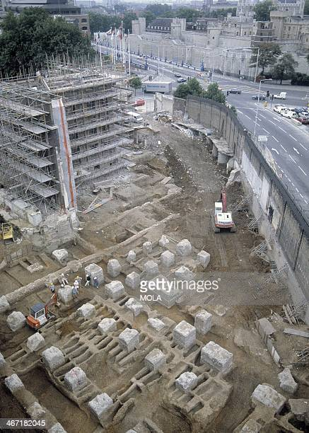 The excavation of the Black Death cemetery at the Royal Mint site East Smithfield London view looking southwest towards the Tower of London