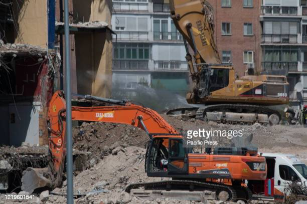 The excavator machine and the drill machine during the demolition. The demolition of the last stand of the formerly fifty five thousand seat capacity...