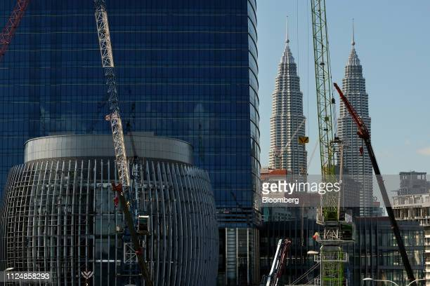 The Exchange 106 building stands under construction on the site of the Exchange TRX precinct as the Petronas Twin Towers are seen in the background...