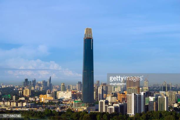 the exchange 106 (formerly trx signature tower) is a skyscraper under construction within the tun razak exchange (trx) area in kuala lumpur, malaysia. - shaifulzamri stock pictures, royalty-free photos & images