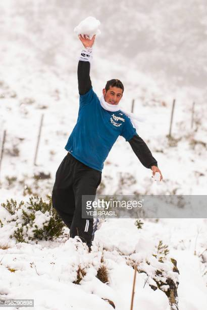The excitement of tourists when seeing snow in Urubici, Santa Catarina, Brazil