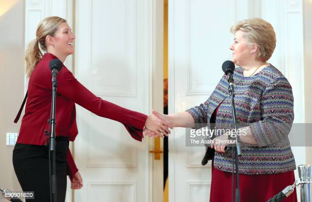 The Executive Director Beatrice Fihn of the International Campaign to Abolish Nuclear Weapons and Norwegian Prime Minister Erna Solberg shake hands...