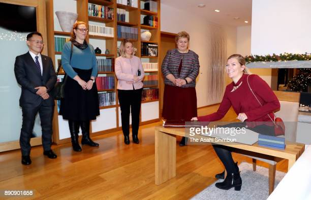 The Executive Director Beatrice Fihn of the International Campaign to Abolish Nuclear Weapons signs a message prior to the meeting with Norwegian...